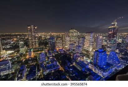 Aerial view de-focused of Bangkok city twilight over Silom road