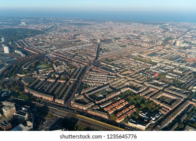 Aerial view of Den Haag, De Schilderswijk in The Netherlands. The district Schildersbuurt is an area downtown with row houses. On the horizon the Noordzee.