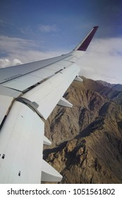 Aerial view of descent through lower Himalayan foothills Leh, Ladakh, India