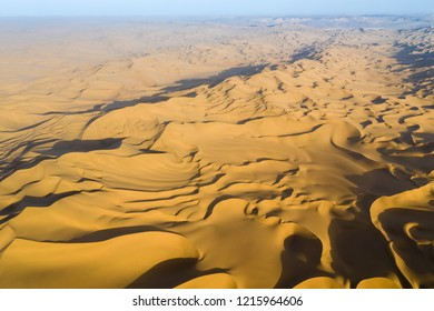 aerial view of desert in sunset, high angle overlooking sand dunes