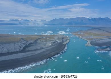 Aerial view of Diamond Beach, the Jökulsárlón glacier bridge and lagoon in Iceland in the morning