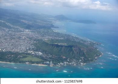 Aerial view of Diamondhead, Kapiolani Park, Waikiki, Natatorium, Kapahulu town, Pacific ocean, clouds, and on Oahu, Hawaii.