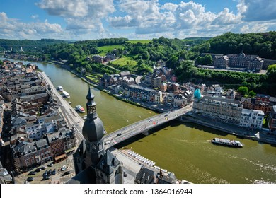Aerial view of Dinant town, Collegiate Church of Notre Dame de Dinant, River Meuse and Pont Charles de Gaulle bridge from Dinant Citadel. Dinant, Belgium