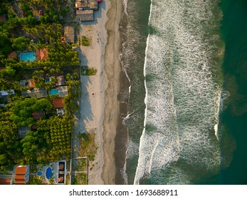 An aerial view directly above the shoreline of the Costa del Sol beach in La Paz, El Salvador.