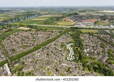 Aerial view of district BOLWONINGEN in Den Bosch, Netherlands. The houses are remarkable because of their spherical, globular shape. On the horizon the highway A2 and river Maas.