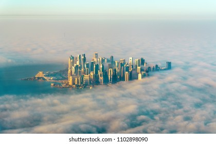 Aerial view of Doha through the morning fog, the capital of Qatar in the Persian Gulf
