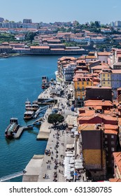 Aerial view of Douro river and Ribeira - famous touristic district in Porto. Portugal.