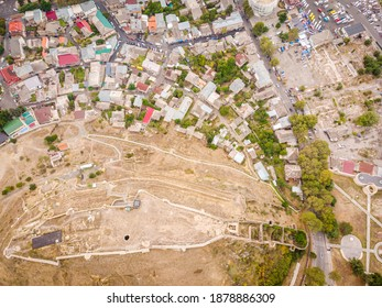 Aerial view down to Gori castle and its wals with city buildings around. - Shutterstock ID 1878886309