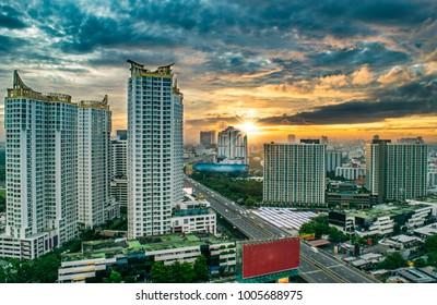 Aerial View of Downtown Bangkok, Apartment Buildings, and Highway/ Freeway at Sunrise - Bangkok, Thailand