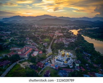 Aerial view of downtown with beautiful mosque in Kuala Kangsar, Malaysia during sunset