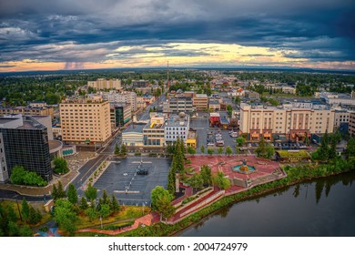 Aerial View of Downtown Fairbanks, Alaska during a stormy Summer Sunset
