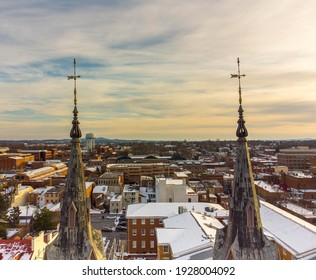 Aerial view of downtown Frederick Maryland through the Evangelical Lutheran Church steeples February 21, 2021