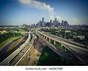 Aerial view downtown and interstate I45 highway with massive intersection, stack interchange, junction and elevated road construction at sunset from northwest side of Houston, Texas, USA. Vintage look