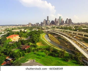 Aerial view downtown and interstate I45 highway with massive intersection, stack interchange, road junction overpass and elevated road construction at sunset from northwest side of Houston, Texas, USA