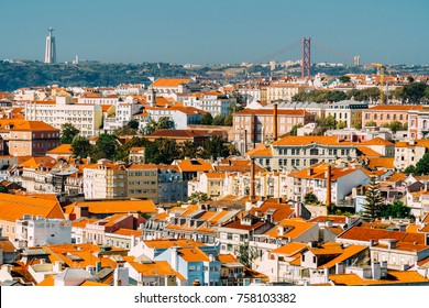 Aerial View Of Downtown Lisbon Skyline Of The Old Historical City And 25 de Abril Bridge (25th April Bridge) In Portugal