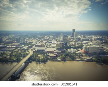 Aerial view downtown Little Rock at the south bank of Arkansas River. Its the capital and most populous city of Arkansas state, US. Main St Bridge and Junction Bridge Pedestrian Walkway across river.