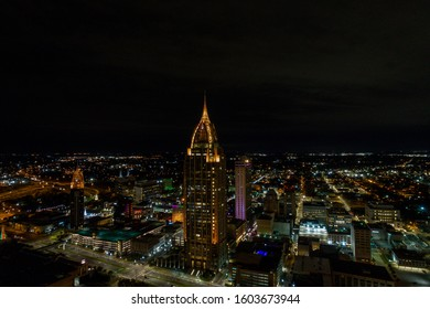 Aerial view of downtown Mobile, Alabama riverside at night