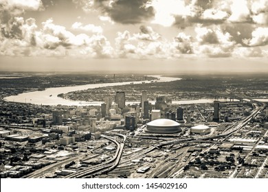 Aerial view of downtown New Orleans and Mississippi river, black & white (sepia).