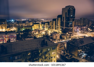 Aerial view at downtown of night city Belgorod, Russia, evening dramatic winter cityscape, toned