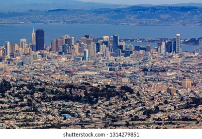 Aerial view of downtown San Francisco and Financial District sky scrapers flying over Glen Park circa 2015