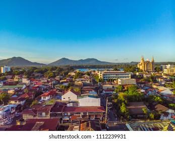 Aerial view of downtown San Pablo City, Laguna (Iglesia ni Cristo, lake, and sky)