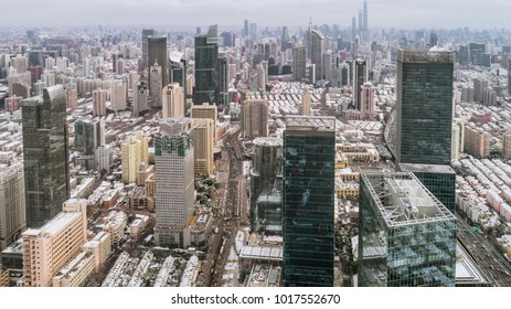 aerial view of downtown Shanghai near Jing An Temple and Nanjin Road after an unusual snowfall in the morning
