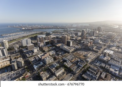 Aerial view of downtown streets, buildings and coastline in Long Beach, California.