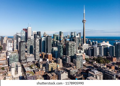 Aerial view of Downtown Toronto including architectural landmark CN Tower on a sunny day in Toronto, Ontario, Canada
