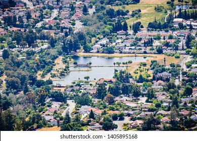 Aerial view of Dr. Robert Gross Groundwater Recharge Pond surrounded by a residential neighborhood, San Jose, South San Francisco bay area