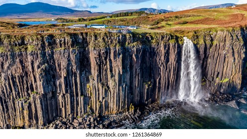 Aerial view of the dramatic coastline at the cliffs by Staffin with the famous Kilt Rock waterfall - Isle of Skye - Scotland.