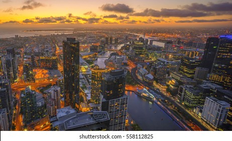Aerial view of dramatic golden sunset at Melbourne city skyline
