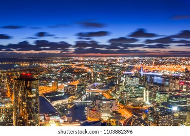 Aerial view of dramatic night sky with crescent moon at Melbourne city skyline