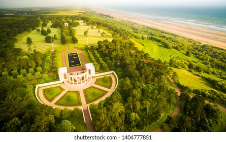 Aerial view to dramatic normandy coast with memorial to dead american soldiers of WW2
