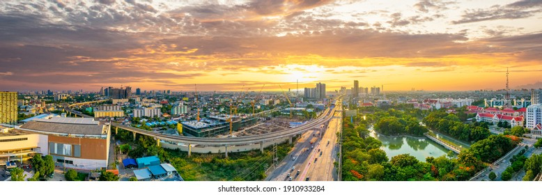 Aerial view of dramatic sunset or sunrise and colorful sky in Bangkok Thailand. bird view over Bangkok city skyline and beautiful colorful clouds at twilight. Asian sky,cityscape with color buildings.