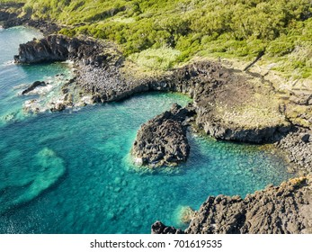 Aerial view of the dramatic volcanic coastline in between the villages of Manadas and Canada de Africa on Sao Jorge island in the Azores.