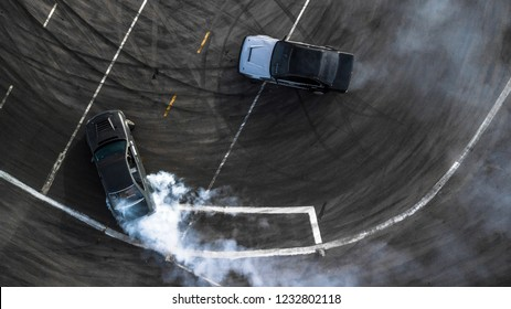 Aerial view drift battle, Two cars drift battle on race track with smoke.