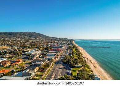 Aerial view of Dromana suburb and Mornington Peninsula coastline