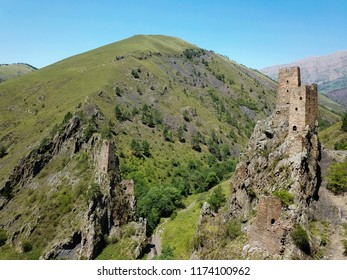 Aerial view from the drone. Mountain Ingushetia, medieval tower complex Vovnushki-stone towers standing on the rocks.