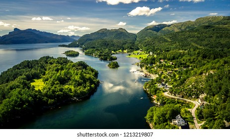 Aerial view from drone on beautiful nature of Norway country. Small green islands next to the coast. Sunny day.