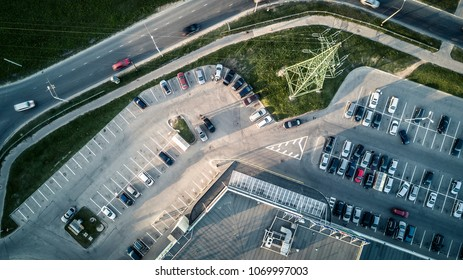 Aerial view from drone on car parking next to the supermarket.