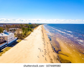 Aerial view from drone on crowd of people who is starting are running on marathon event by the sea shore in Jurmala, Latvia.