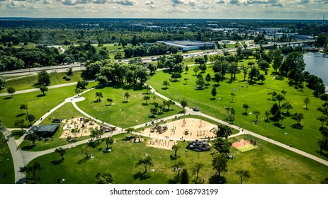 Aerial view from drone on the green park in the middle of city Riga, Lucavsala, Latvia. Nice place to have a rest.