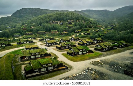 Aerial view from drone on some special village with roofs covered with green grass in Norway.