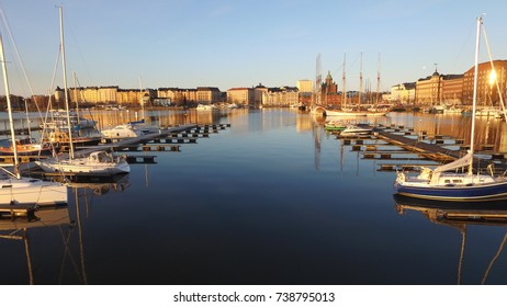 aerial view drone photo of Helsinki bay area near sea terminal Katajanokka and harbour with city skyline, moored boats and vessels and Baltic Sea view in the capital of Finland, northern Europe