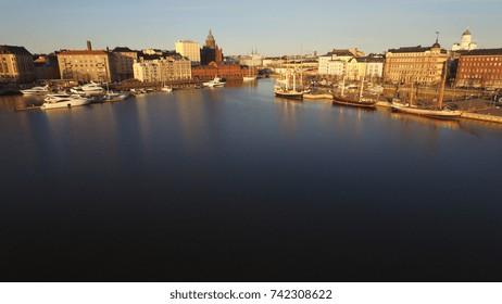 Aerial view drone photo of Helsinki bay area near sea terminal Katajanokka and harbour with city skyline