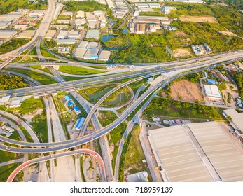 Aerial view from drone of road junction with overpass of the expressway (motorway), Thailand