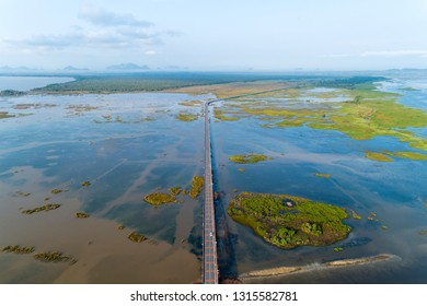 Aerial view Drone shot of Bridge(Ekachai bridge)Colorful Road bridge cross the lake at Talay Noi Lake in Phatthalung province Thailand.