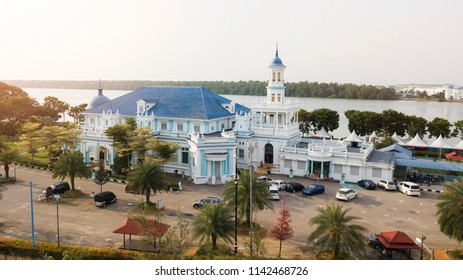 Aerial view from drone shot of Muslim mosque in small city during sunny day in Johor, intentionally with noise and grain.