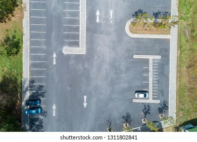 Aerial view drone shot of parking lot outdoors vehicles in the park.