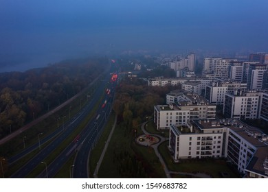 Aerial view of the drone shows the impressive elevation of the highway and the convergence of roads, bridges, viaducts on a foggy morning in Warsaw, Poland.